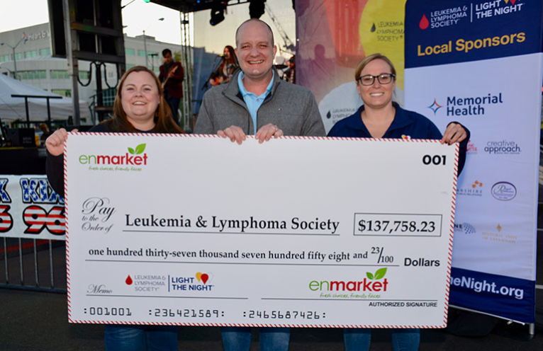 Sean Fatzinger for representing Enmarket (Enmark Stations Inc.) and presenting the check at the Light The Night Event Leukemia and Lymphoma Society in Savannah GA.